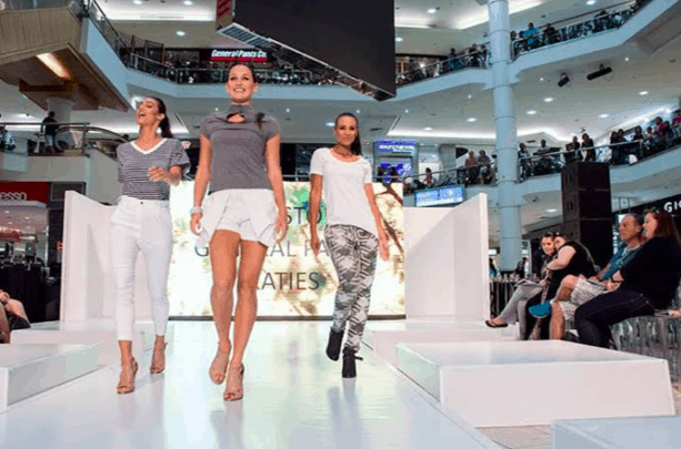 Models walk runway for Fashion Saturday.