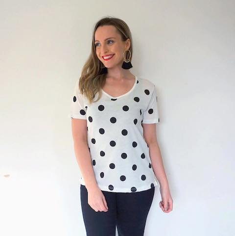 Hayley Cooper models a polka dot shirt.