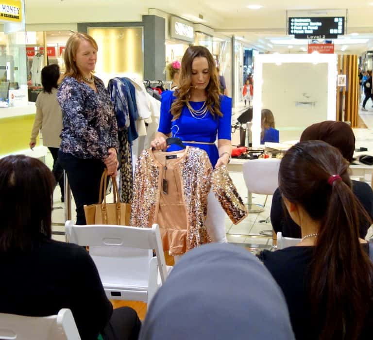 Hayley Cooper displaying sparkling jacket at a style workshop.