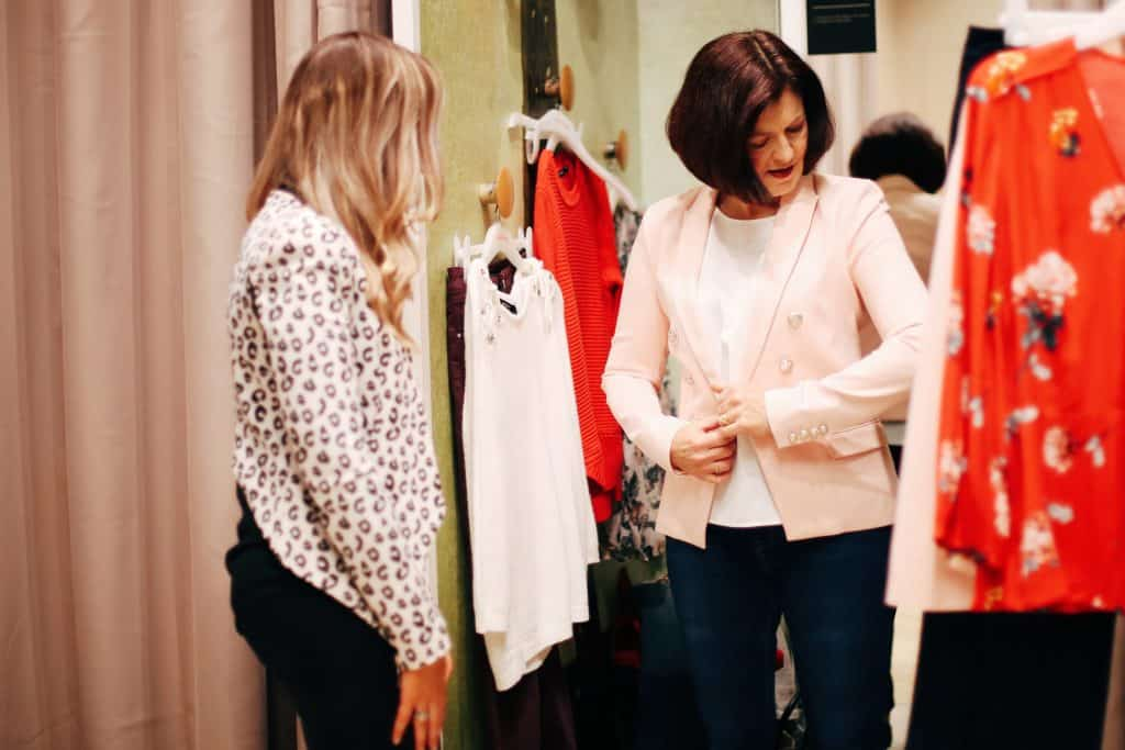 Hayley Cooper's client trys on a jacket at a personal shopping session