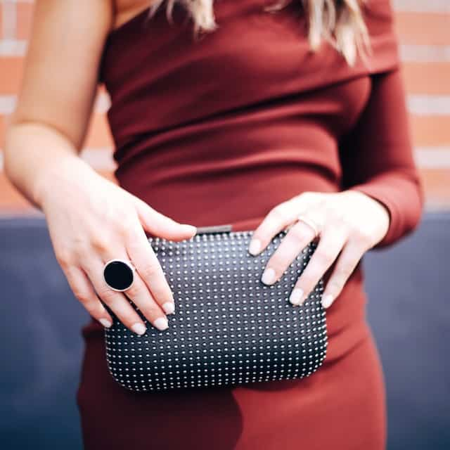 Hayley Cooper models clutch and ring.