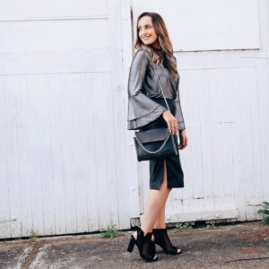 Hayley Cooper models silver top, skirt and bag.