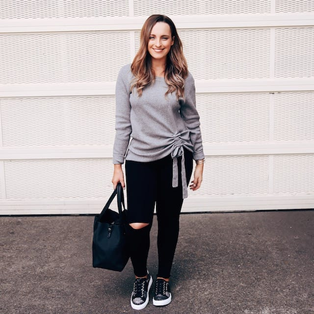 Hayley Cooper models sweater, shoes, jeans and bag.