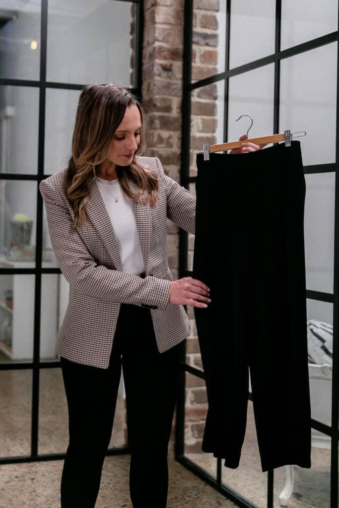 Hayley Cooper inspects black pants.