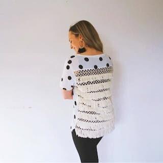 Hayley Cooper models a polka dot shirt.