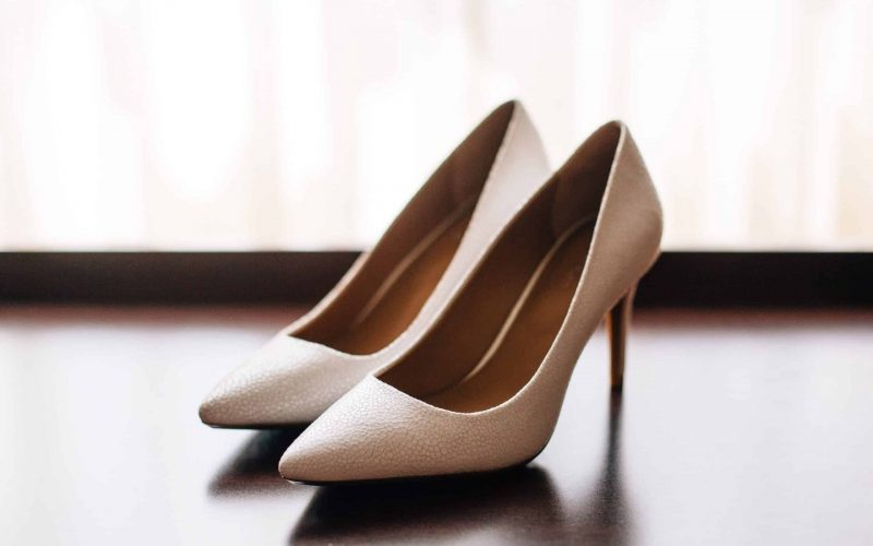 A pair of beige stilettos.