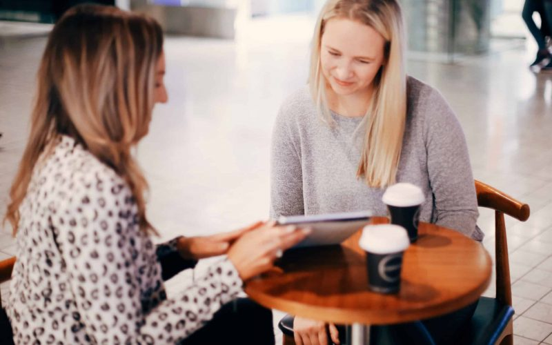 Hayley Cooper has a coffee meeting with a client.