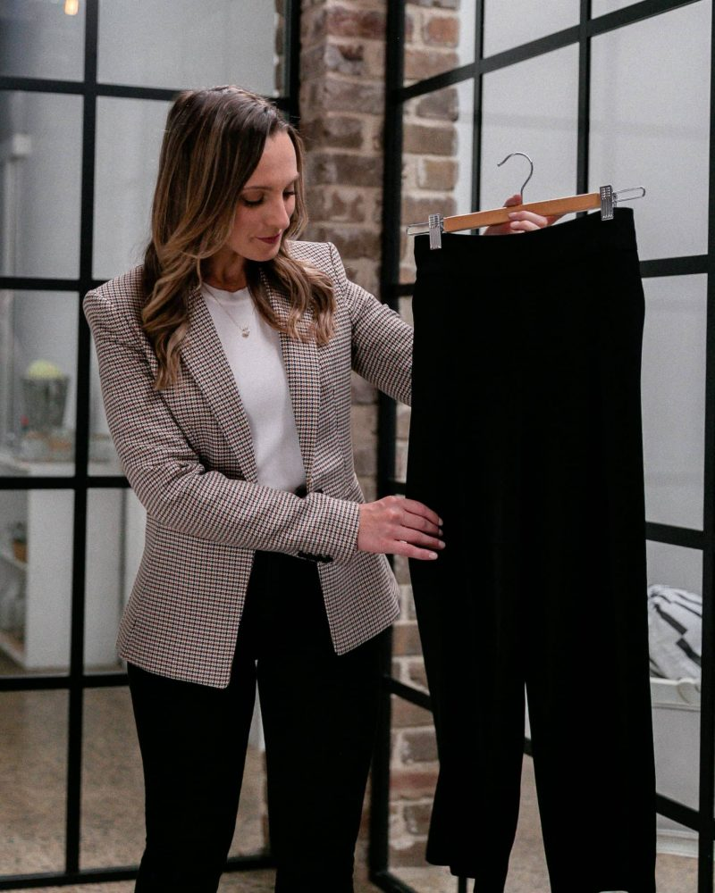 Hayley Cooper inspects black pants.